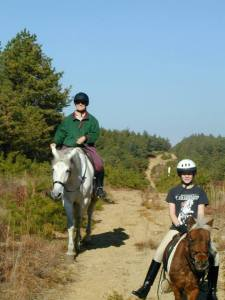 My trainer Ainslie and me trail riding when I was 9. I learned to wear a helmet from a young age.
